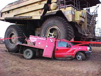 dump truck driving over pickup pinnacle auto appraiser appraisal dimished value